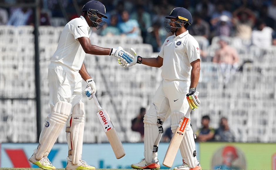 India's Karun Nair, right, shakes hand with Ravichandran Ashwin after their partnership run reached hundred against England during their fourth day of the fifth cricket test match in Chennai, India, Monday, Dec. 19, 2016. (AP Photo/Tsering Topgyal)