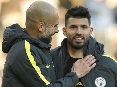 Pep Guardiola with Sergio Aguero (R). Reuters
