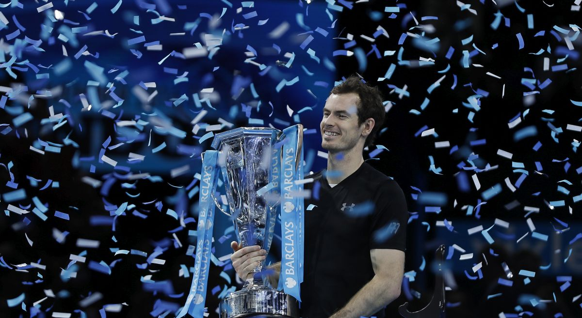 Andy Murray of Britain holds the trophy after winning the ATP World Tour Finals singles final tennis match against Novak Djokovic of Serbia at the O2 Arena in London, Sunday, Nov. 20, 2016. (AP Photo/Kirsty Wigglesworth)