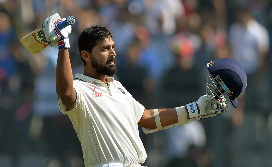 India's Murali Vijay celebrates after scoring a century (100 runs) on the third day of the fourth Test cricket match between India and England at the Wankhede stadium in Mumbai on December 10, 2016. AFP