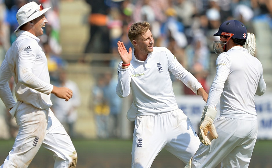 England's Joe Root (C) celebrates with teammates after the dismissal of India's Ravichandran Ashwin on the third day of the fourth Test cricket match between India and England at the Wankhede stadium in Mumbai on December 10, 2016. AFP