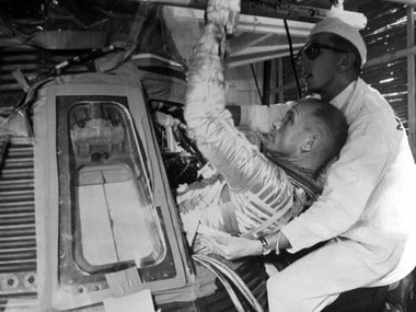 A file image of John Glenn (left) being helped into the Mercury capsule Friendship 7 during training for his Feburary 20, 1962, space flight.  AFP