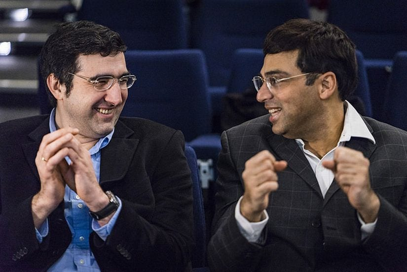 Two former World Champions, Vladimir Kramnik and Viswanathan Anand, spend a light moment together before the fifth round. (image courtesy: Lennart Ootes)