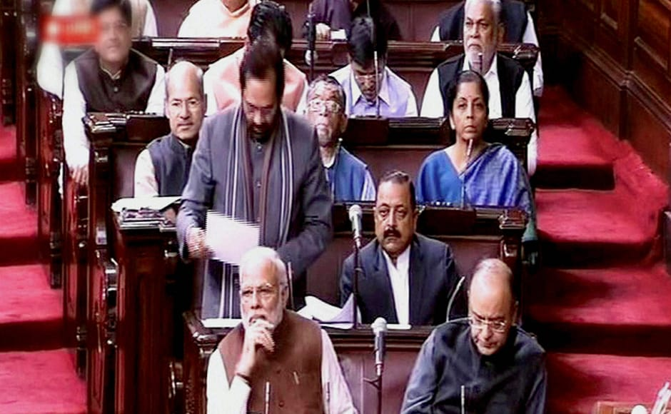 MoS for Parliamentary Affairs, Mukhtar Abbas Naqvi speaks in the Rajya Sabha in New Delhi on Friday. Prime Minister Narendra Modi, Finance Minister Arun Jaitley and MoS for PMO Jitendra Singh are also seen. PTI