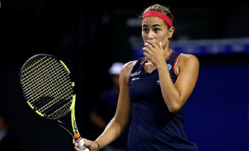 Tennis - Pan Pacific Open Women's Singles Quarterfinal match - Ariake Coliseum, Tokyo, Japan - 23/09/16.  Monica Puig of Puerto Rico reacts after losing a point by Agnieszka Radwanska of Poland.   REUTERS/Kim Kyung-Hoon