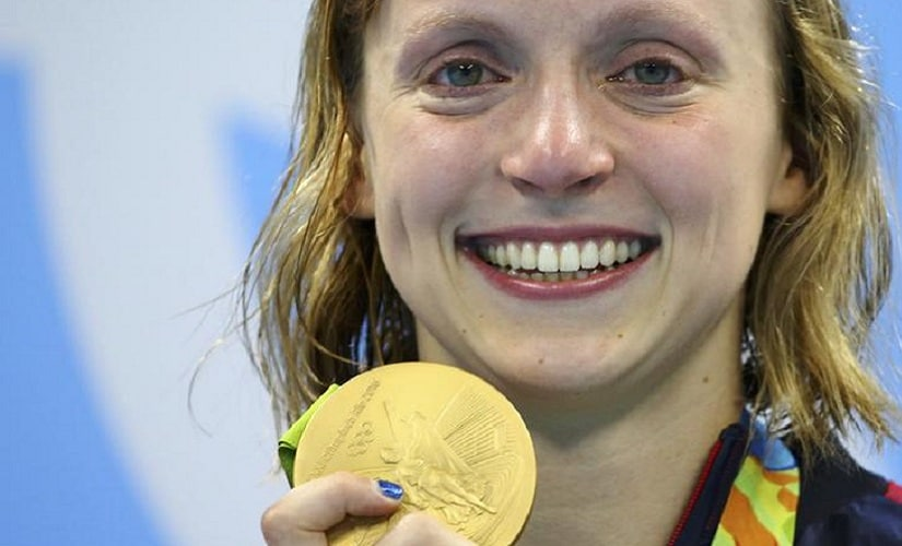 2016 Rio Olympics - Swimming - Victory Ceremony - Women's 800m Freestyle Victory Ceremony - Olympic Aquatics Stadium - Rio de Janeiro, Brazil - 12/08/2016. Katie Ledecky (USA) of USA poses with her gold medal on the podium.   REUTERS/Dominic Ebenbichler FOR EDITORIAL USE ONLY. NOT FOR SALE FOR MARKETING OR ADVERTISING CAMPAIGNS.