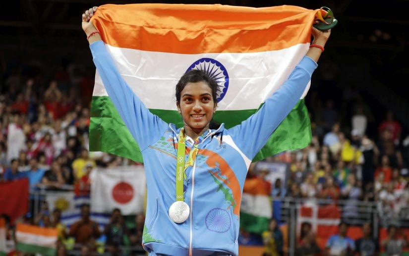 India's V. Sindhu Pusarla wears her silver medal during the medal ceremony for women's badminton singles at the 2016 Summer Olympics in Rio de Janeiro, Brazil, Friday, Aug. 19, 2016. (AP Photo/Kin Cheung)