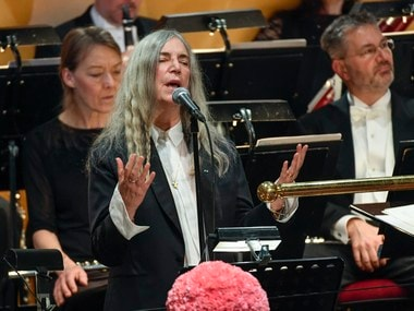 US singer Patti Smith performs 'A Hard Rain's A-Gonna Fall' by absent 2016 Nobel literature laureate Bob Dylan during the 2016 Nobel prize award ceremony at the Stockholm Concert Hall on Saturday. AP