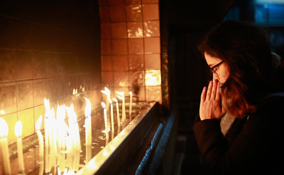 In Turkey, people offered their prayers and lit candles prior to a Christmas Eve mass in Sent Antuan church, the largest church of the Roman Catholic Church in Istanbul. AP