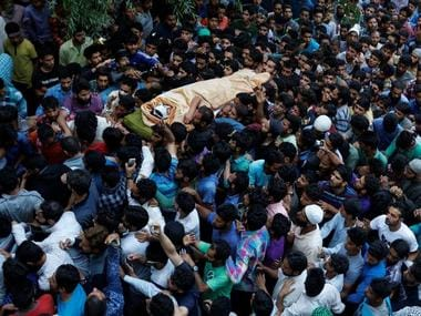 Kashmiris carry the body of Burhan Wani, a separatist militant leader, during his funeral in Tral, south of Srinagar. Reuters