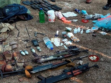 Jammu: Army men showing arms and other items recovered from militants who attacked Nagrota camp, near Jammu on Wednesday. PTI Photo   (PTI11_30_2016_000286B)