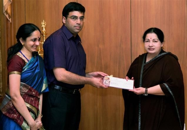 Anand and his wife Aruna with Jayalalithaa after winning World Championship 2012.
