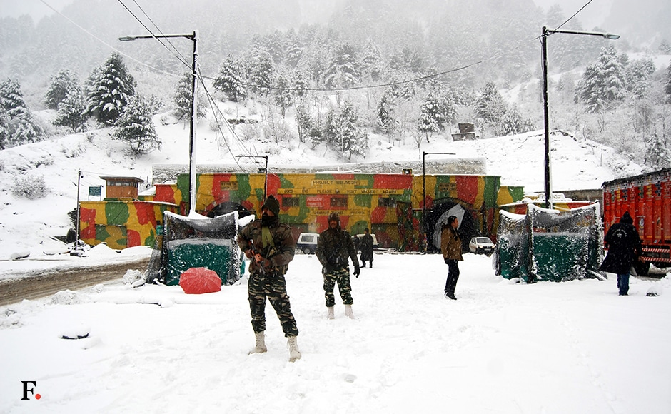 Security forces deployed outside Jawahar tunnel, the only road link between valley and rest of India which was closed due to heavy snow on Friday. Snowfall hampered efforts to re-open the highway for traffic. All flights were also cancelled due to snowfall. Image courtesy Hilal Shah