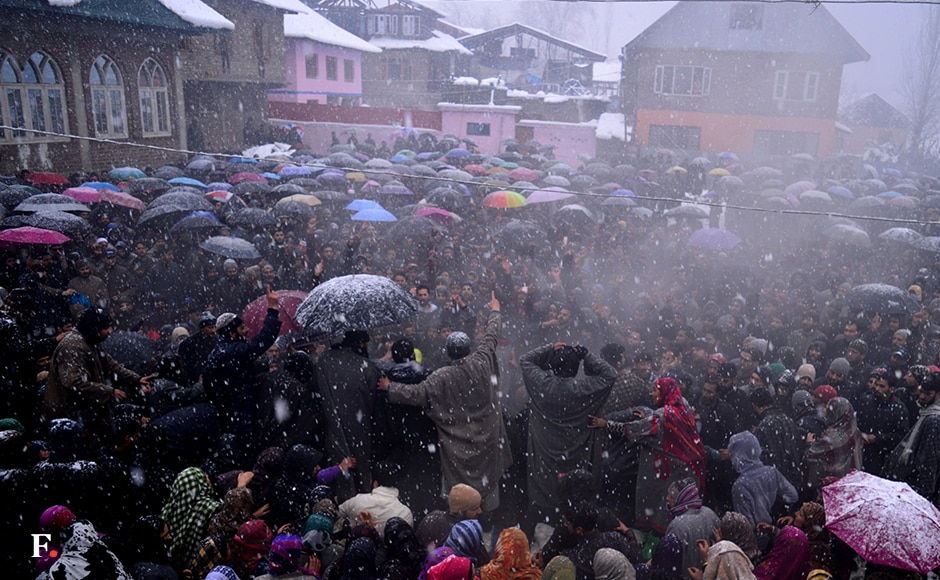 A protester shouts slogans during the funeral process of Muzaffar Iqbal Naikoo, a militant from Sopore area of north Kashmir, who was killed by security forces in a midnight gunfight on the outskirts of Srinagar. Thousands of people, braving snowfall, participated in his funeral at his native village. Image courtesy Eeshan Peer