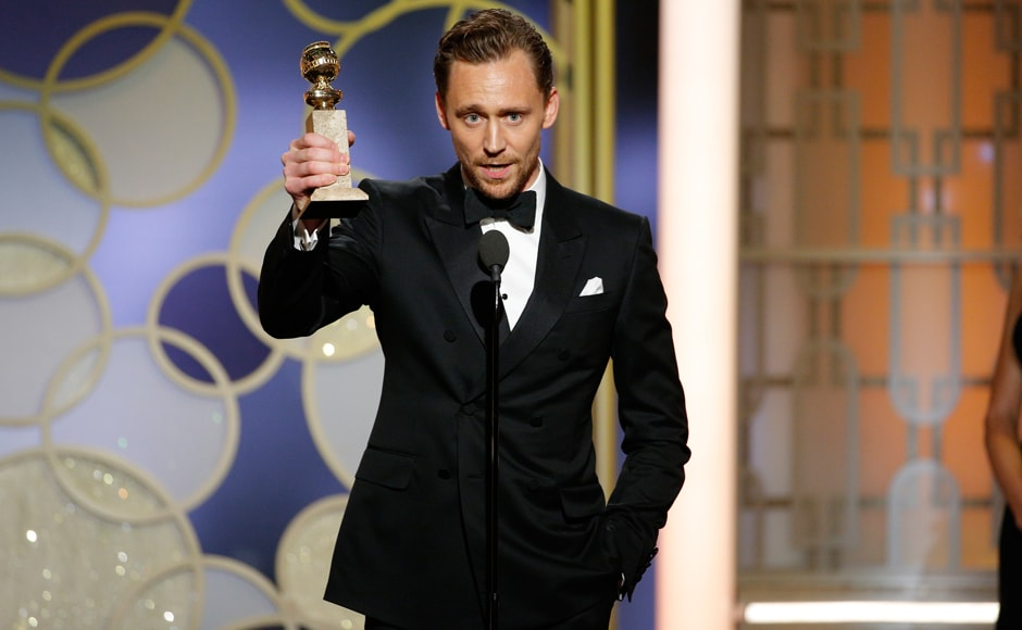 This image released by NBC shows Tom Hiddleston with the award for best actor in a limited series or TV movie for