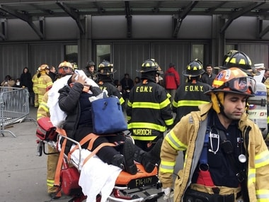An injured passenger, after a Long Island Rail Road commuter train either hit something or derailed. AP