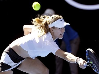 Eugenie Bouchard reaches for a return to China's Peng Shuai. AP