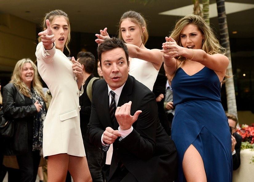 Jimmy Fallon, host of the 74th Annual Golden Globe Awards, poses with Miss Golden Globes 2017, from left, sisters Sistine, Scarlet and Sophia Stallone after rolling out the red carpet during Golden Globe Awards Preview Day at the Beverly Hilton on Wednesday, 4 January 2017, in Beverly Hills. The awards will be held on Sunday. AP Photo
