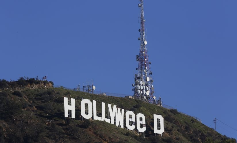 "Los Angeles residents awoke New Year's Day to find a prankster had altered the famed Hollywood sign to read ""HOLLYWeeD."" AP"