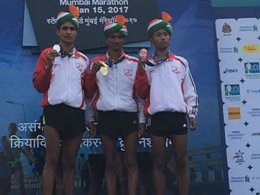 The Indian men on the podium. Image Credit: Twitter @runscmm
