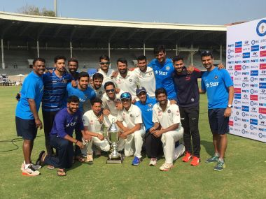 Rest of India side pose with the Irani Trophy. Image Courtesy: Twitter@/BCCIDomestic