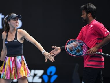 Martina Hingis and Leander Paes in action at the Australian Open. AFP