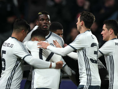 Paul Pogba of Manchester United celebrates with his team-mates after scoring a goal to make the score 1-1 during the EFL Cup Semi-Final second leg. Getty Images