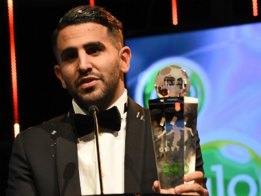 Riyad Mahrez accepts his award. AFP