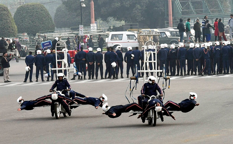 Army daredevils display their skills on motorcycles during a rehearsal for the Republic Day parade at Vijay Chowk in New Delhi on Tuesday. PTI