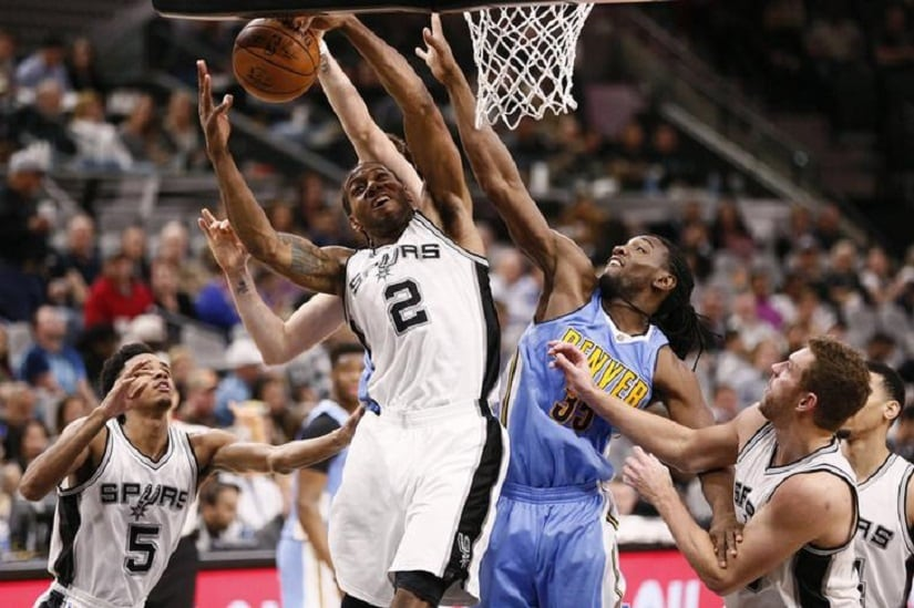Jan 19, 2017; San Antonio, TX, USA; San Antonio Spurs small forward Kawhi Leonard (2) grabs a rebound as Denver Nuggets power forward Kenneth Faried (35) defends during the second half at AT&T Center. Mandatory Credit: Soobum Im-USA TODAY Sports