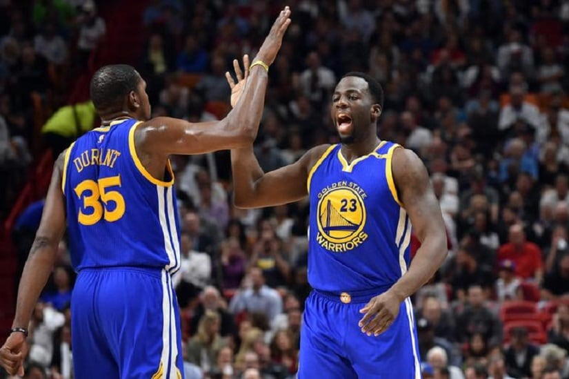 Jan 23, 2017; Miami, FL, USA; Golden State Warriors forward Draymond Green (right) celebrates with Warriors forward Kevin Durant (left) during the first half against the Miami Heat at American Airlines Arena. Mandatory Credit: Steve Mitchell-USA TODAY Sports