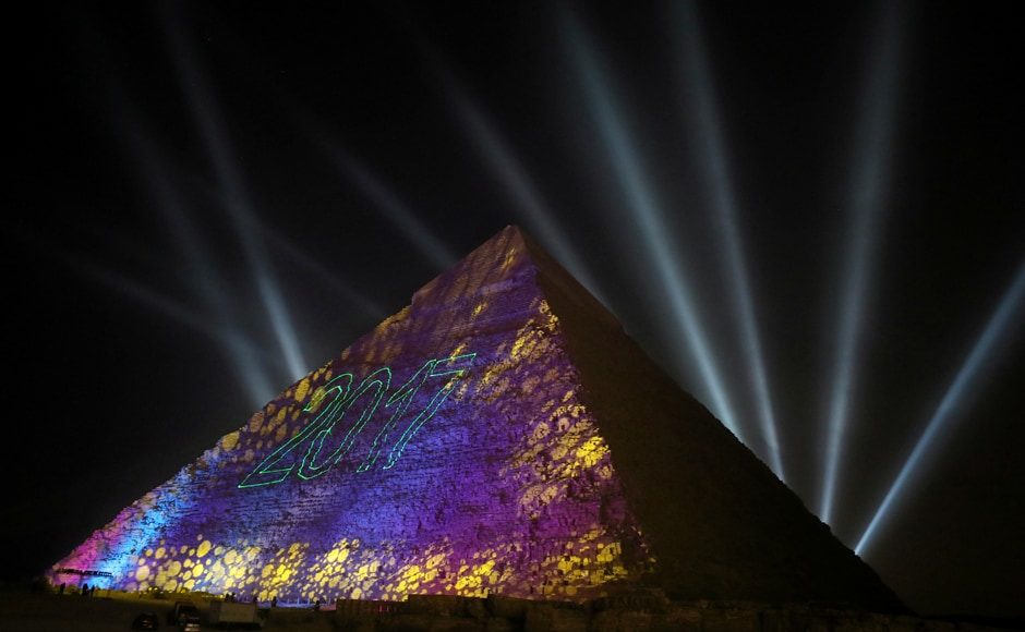 Lights reading 2017 are projected on the pyramids during New Year's day celebrations on the outskirts of Cairo, Egypt. Reuters