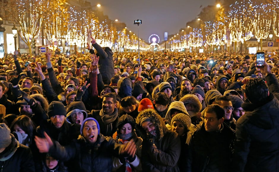 Revellers gather on the Champs Elysees Avenue in Paris, France, during New Year celebrations. Reuters