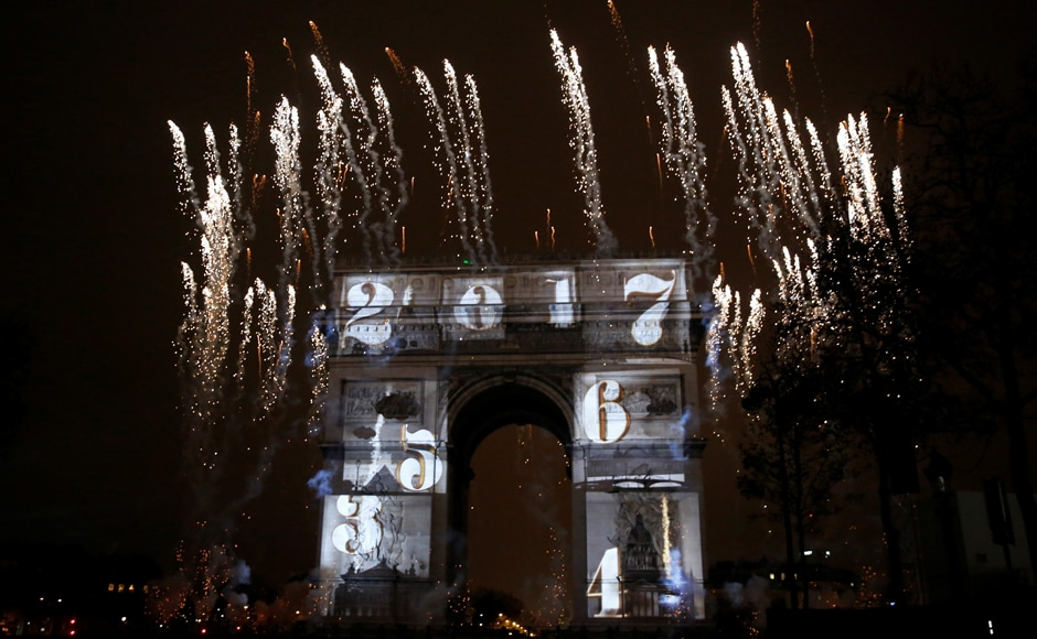 View of a light show on the city's iconic Arc de Triomphe monument during the New Year celebration in Paris, France. Reuters