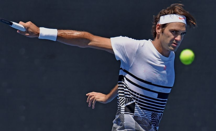 Roger Federer hits a return during a practice session ahead of the Australian Open. AFP