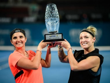 Sania Mirza and Bethanie Mattek-Sands lift their Brisbane International title. Image credit: Twitter/@BrisbaneTennis