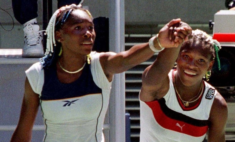 Venus Williams, left, and her sister Serena at the Australian Open in 1998, their first career clash against each other. Reuters