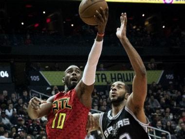 Hawks' Tim Hardaway (L) takes a shot. AP