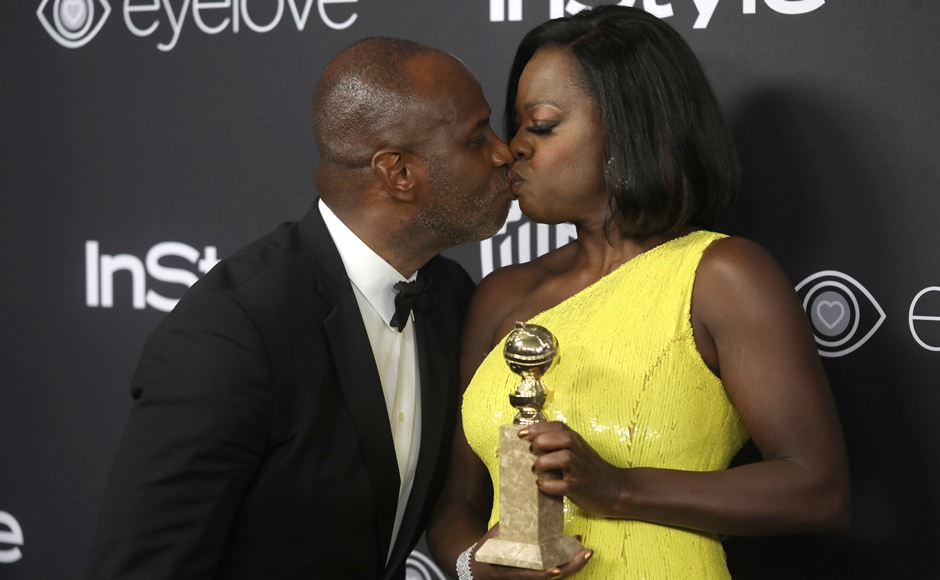 Viola Davis, right, winner of the award for best performance by an actress in a supporting role in a motion picture for