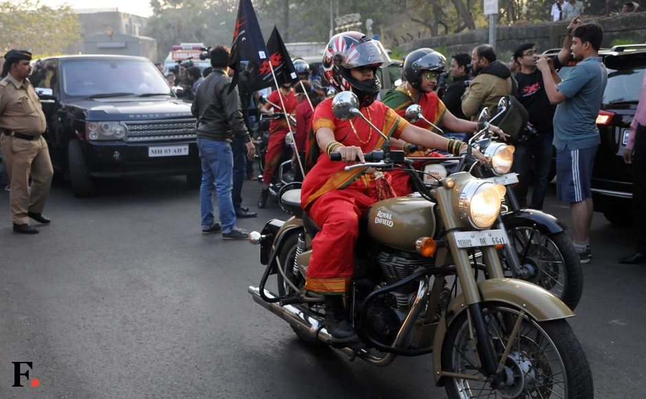 The young women arrive in style on bullets and decked up in traditional red attire. Sachin Gokhale/Firstpost