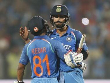 Indian captain Virat Kohli celebrates with teammate Kedar Jadhav. AP