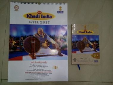 Narendra Modi replaces Gandhi in charkha photo: What is the BJP govt trying to prove?