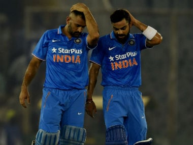 File photo of Dhoni (L) and Kohli. AFP