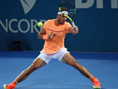 Nadal returns against Milos Raonic in their men's singles quarter-final in the Brisbane International. AFP