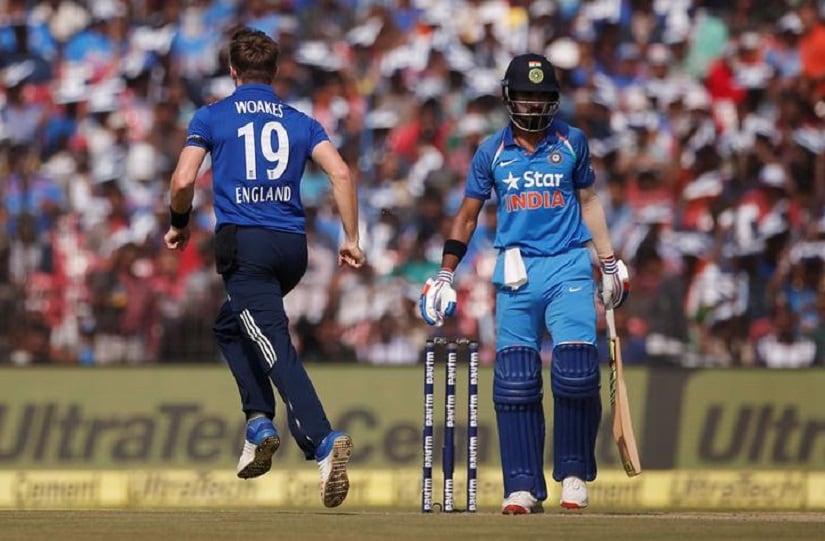 Cricket - India v England - Second One Day International - Barabati Stadium, Cuttack, India - 19/01/17. England's Chris Woakes (L) celebrates the dismissal of India's Lokesh Rahul. REUTERS/Adnan Abidi