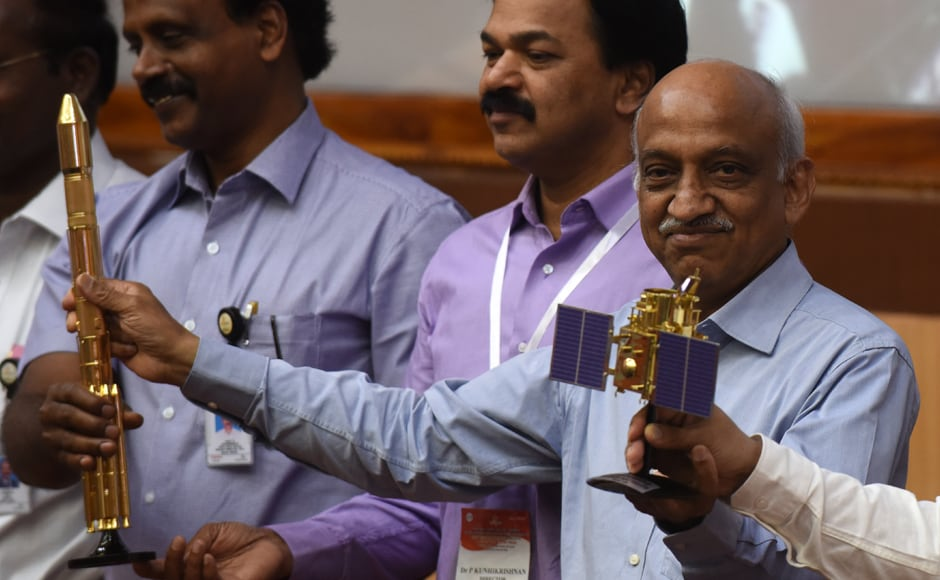 Indian Space Research Organisation (ISRO) chairman Kiran Kumar Rao (R) displays models of the CARTOSAT-2 and Polar Satellite Launch Vehicle (PSLV-C37) as he speaks to media after the launch of the Polar Satellite Launch Vehicle (PSLV-C37) at Sriharikota on Wednesday. AFP