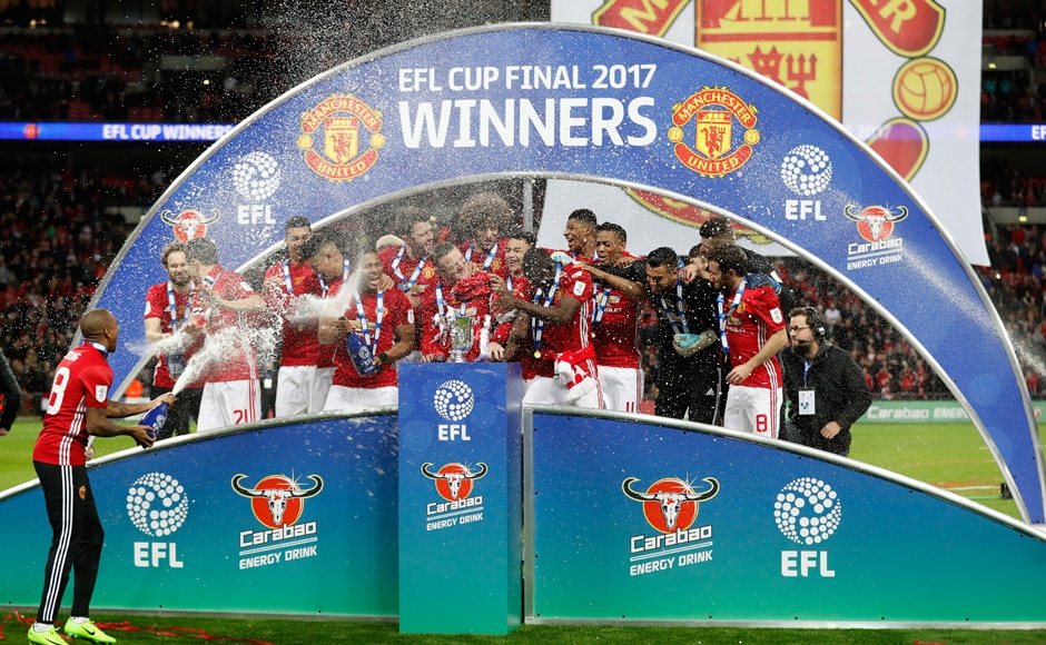 """Britain Soccer Football - Southampton v Manchester United - EFL Cup Final - Wembley Stadium - 26/2/17 Manchester United players celebrate with the trophy at the end of the match Action Images via Reuters / Carl Recine Livepic EDITORIAL USE ONLY. No use with unauthorized audio, video, data, fixture lists, club/league logos or """"live"""" services. Online in-match use limited to 45 images, no video emulation. No use in betting, games or single club/league/player publications. Please contact your account representative for further details."""