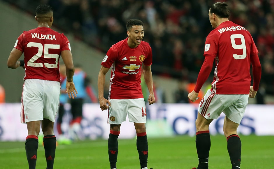 Manchester United's Jesse Lingard,center, Manchester United's Zlatan Ibrahimovic, right, and Manchester United's Antonio Valencia celebrate after scoring during the English League Cup final soccer match between Manchester United and Southampton at Wembley stadium in London, Sunday, Feb. 26, 2017.(AP Photo/Tim Ireland)