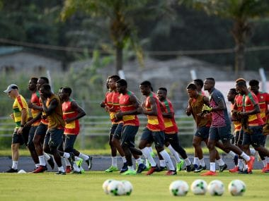 Cameroon's players run during a training session on the eve of the final of the 2017 Africa Cup of Nations. AFP
