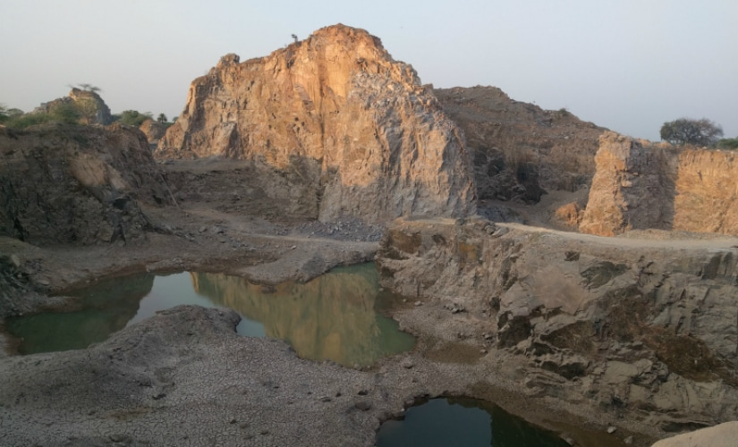 Small mountains and hills have been sliced for stone mining and quarrying. Firstpost/Debobrat Ghose